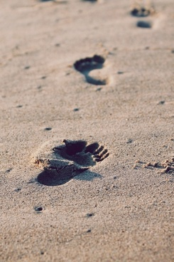 beach close up foot footprint pebble sand walking