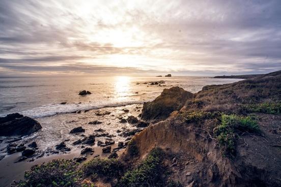 beach coast coastline evening landscape nobody ocean
