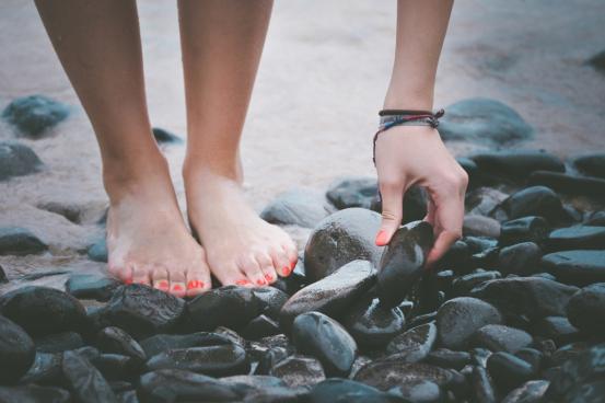 black small wet stones on beach