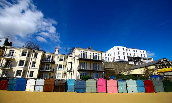 beach huts amp blue sky