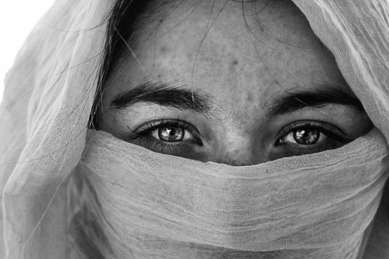 black white photo of muslim woman