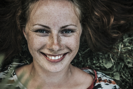beautiful woman with lots of freckles on face