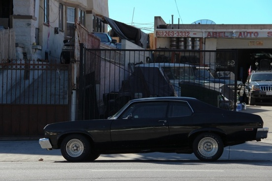 black classic muscle car on street