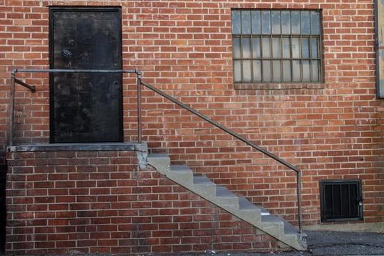 black door 038 staircase on brick building