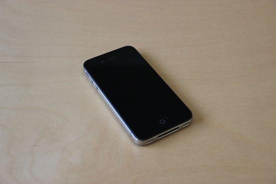 black iphone on light wood