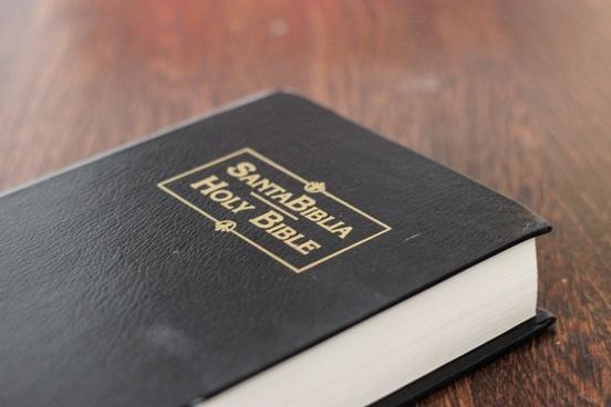 black spanish bible on table