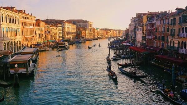 boat bridge building canal channel city evening