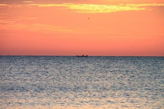 boat dark fisherman
