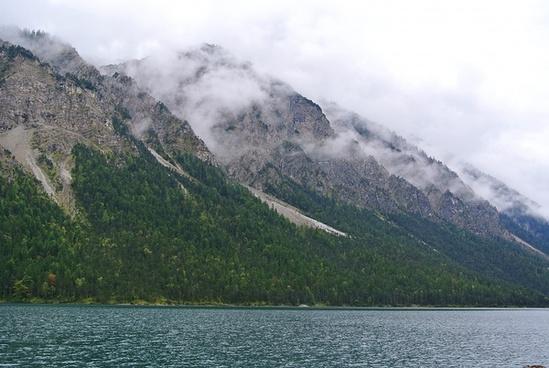 boat fjord fog forest hill island lake landscape