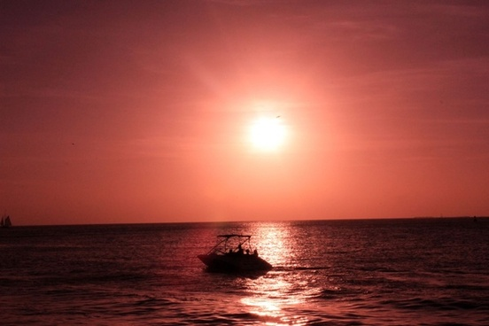 boat under the red sun at key west florida