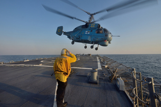 boatswains mate 3rd class jennifer sahley salutes as a ukrainian navy helicopter