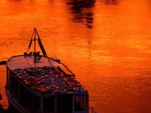 boot water sunset red orange