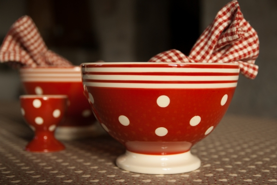 closeup of traditional red pottery bowls and cups
