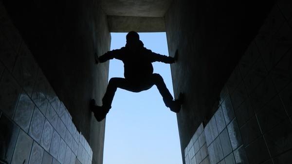 boy climbing wall sport climbing