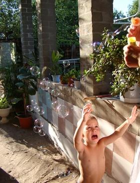 boy soap bubbles sun