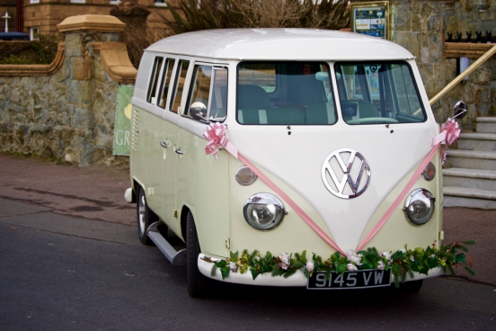 classical car decorated with ribbon and flowers