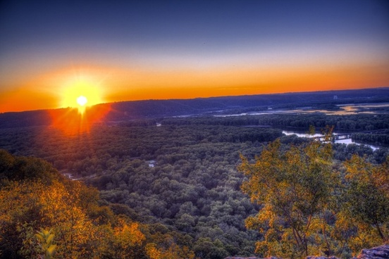 bright sunset over the mississippi valley at wyalusing state park wisconsin