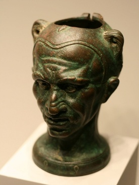 bronze cup with face of a man