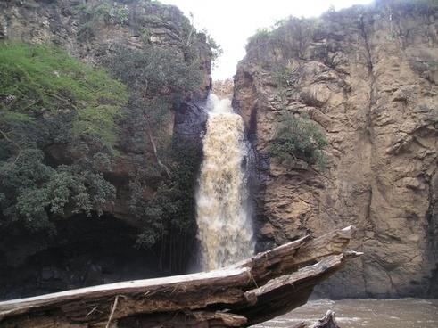 brown waterfull through rocky cliffs
