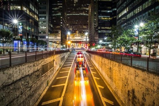 building car city downtown evening fast headlight