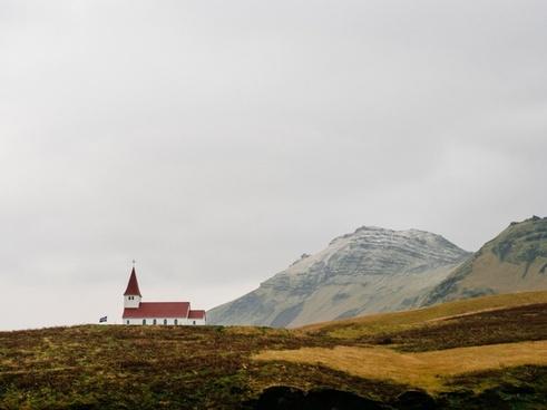 building church field flag grass hill landscape