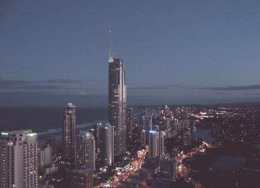 building city evening light ocean road sea shore