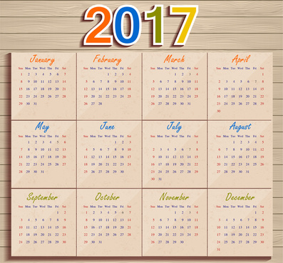 calendar 2017 templates paper on wooden background