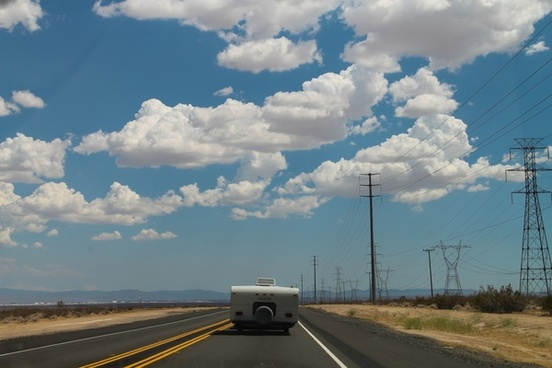 camper driving on desert road