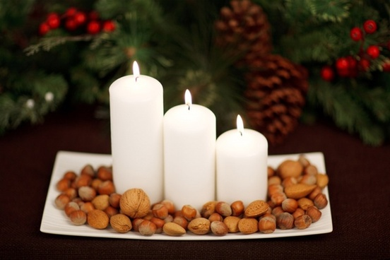candles and nuts on plate