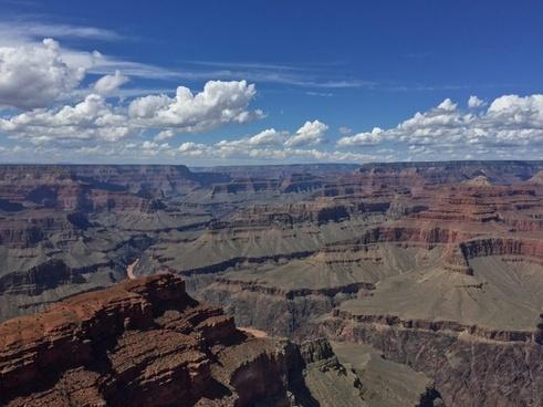 canyon daytime desert dry geology landscape majestic