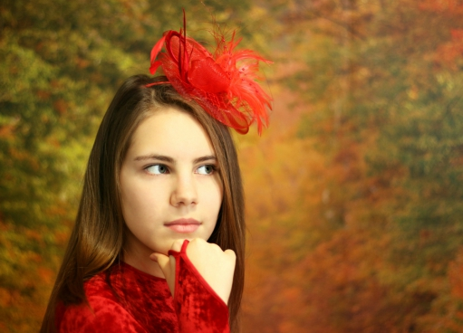 beautiful girl posing with red bow on hair