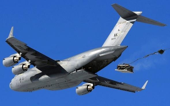 cargo jet c-17 airdrop of a humvee