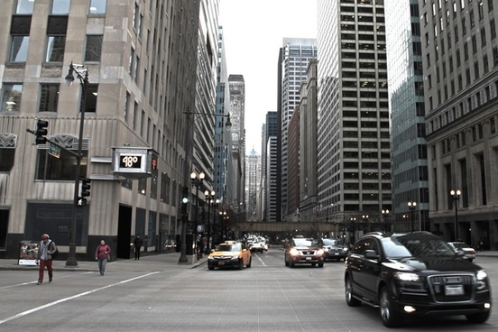 cars approaching on busy street in city