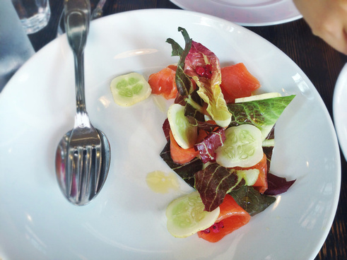 chamomile cured salmon with salted berries and cucumber