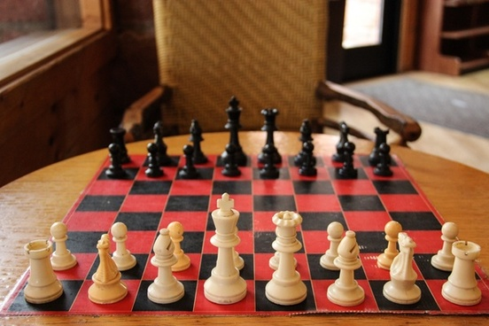 chess board on table with chair