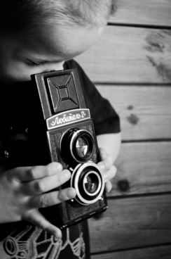 child and reflex camera