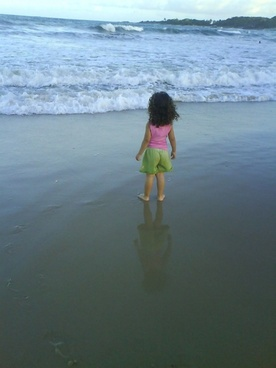 child looking at the sea