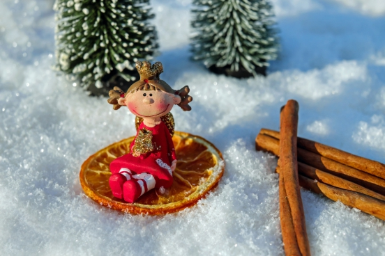 cute decorative doll on snow