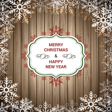 christmas greeting on wooden planks with snowflakestexture
