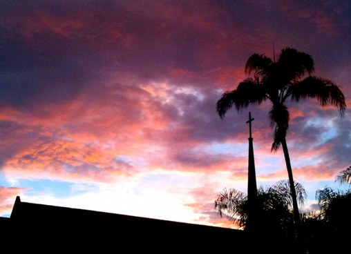 church steeple silhouette on sunset clouds