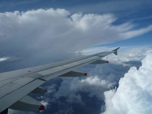 circling around a massive storm cloud
