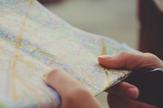 city close up finger hand map paper reading tourism