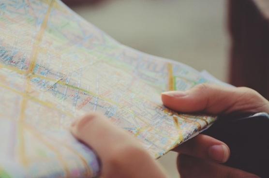 city close up finger hand map paper reading tourism