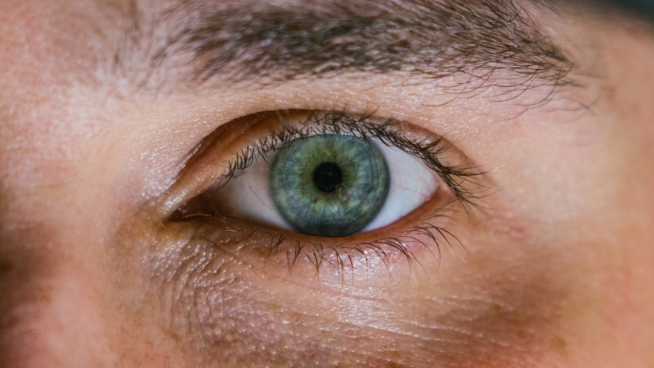 closeup of green eye of man