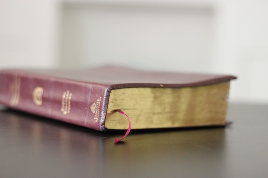 closed leather bible on table