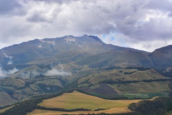 cloud daytime grass grassland hill lake landscape