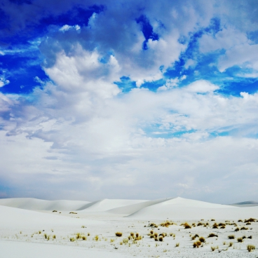 big cloudscape above white desert