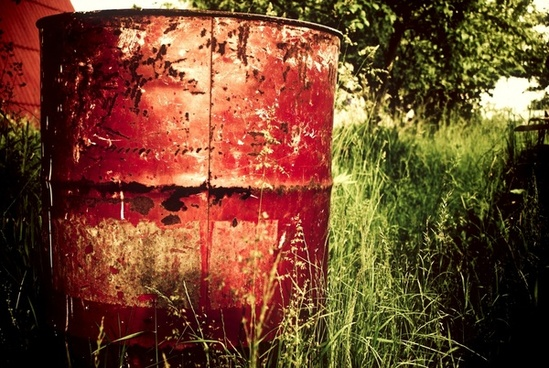 container drum field grass oil rust tree