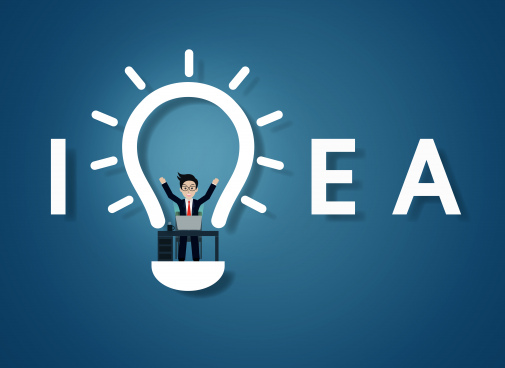creative idea text light bulb icon on blue background businessman in workspace sit at the desks with computer with lamp decoration over his head one person logo vector illustration