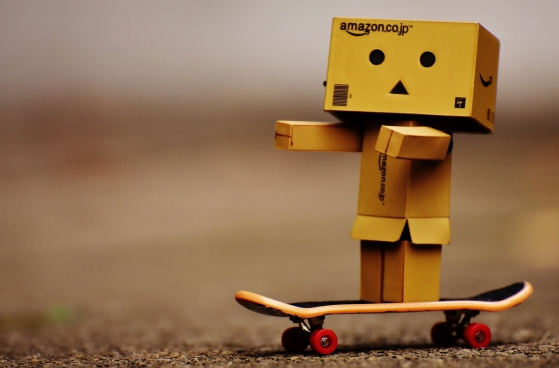 tiny wooden robotic toy model with skateboard